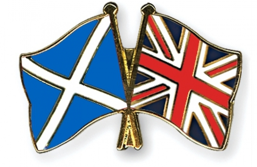 flags of Scotland and the United Kingdom together