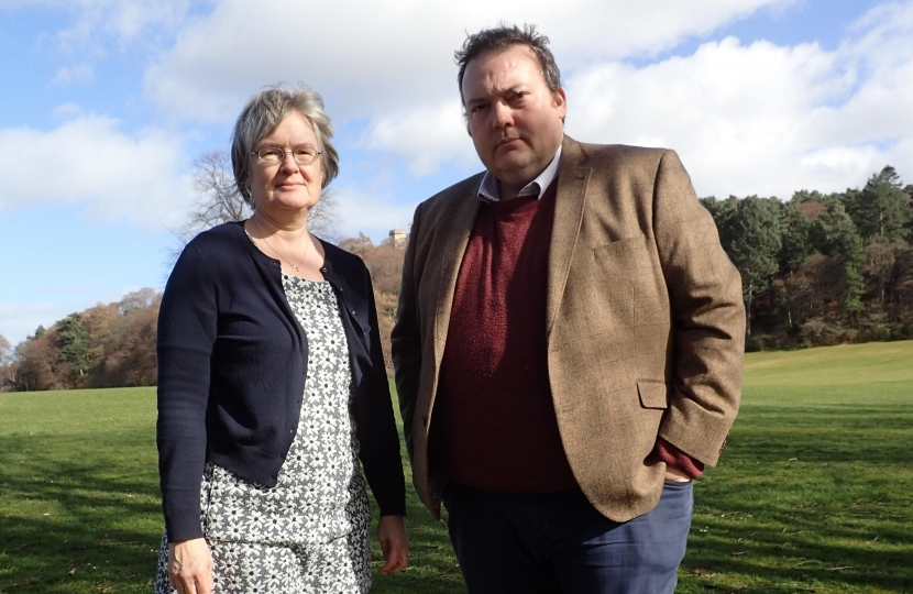 Councillor Claire Feaver and MSP Jamie Halcro Johnston standing in a park in Forres
