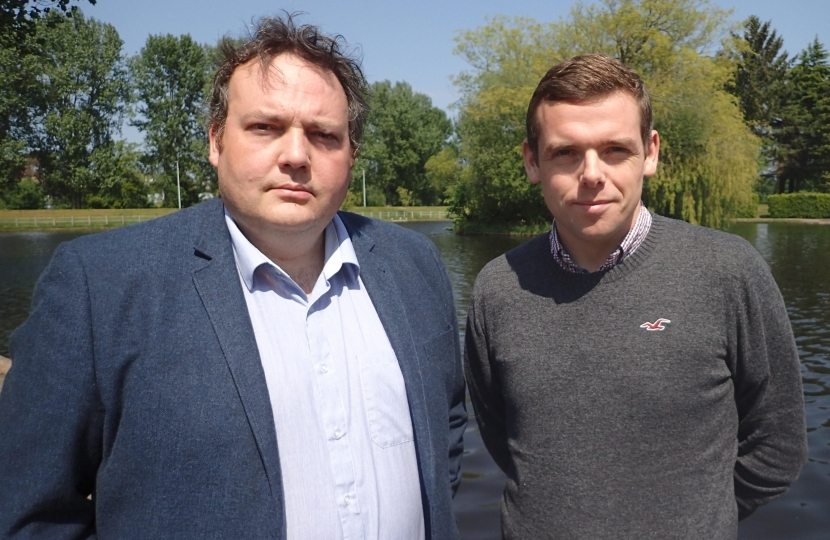 Jamie Halcro Johnston standing with Douglas Ross MP in a park in Elgin